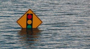Road sign submerged in flood water